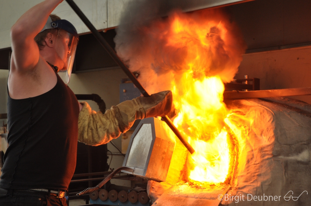 The Glass Studio : throwing kerosene into the furnace..