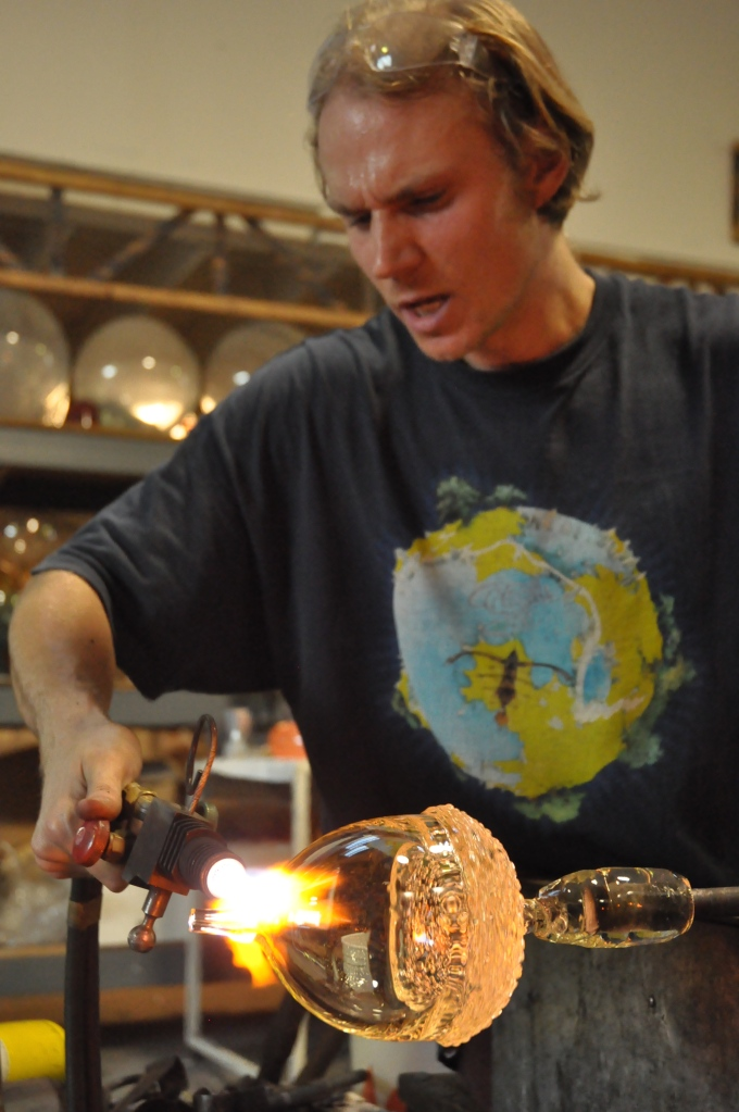 Jason Stropko creating a special order, extra large, blown clear glass acorn..